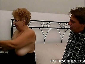 Chubby mature granny gives young stud good time in bed