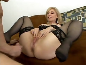 Classy blonde cougar in lingerie eats cum after being analyzed