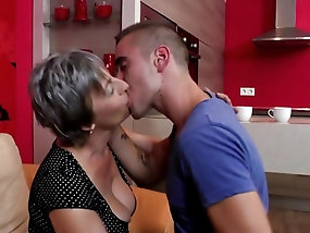 Busty mature woman spreads her legs for a young tool